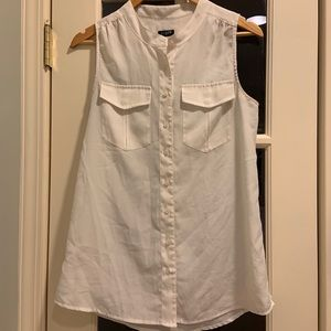 White sleeveless blouse with two front pockets